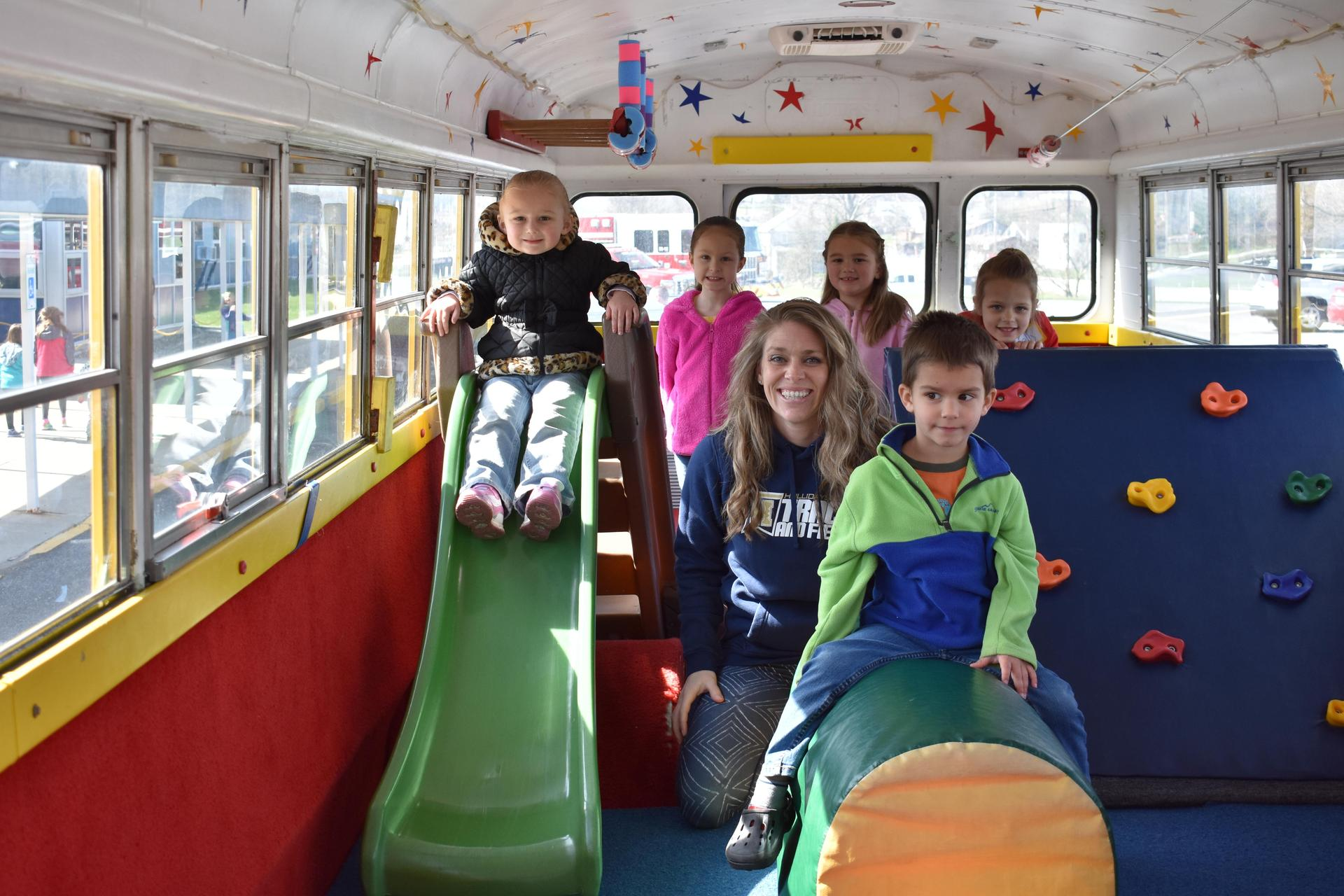 Students playing in fun bus