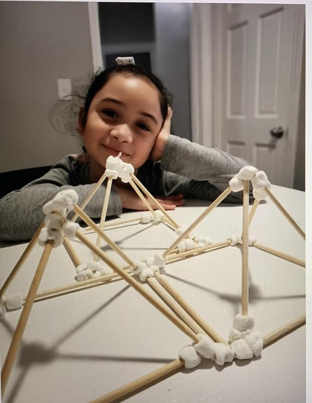 Eva with her pyramids design model