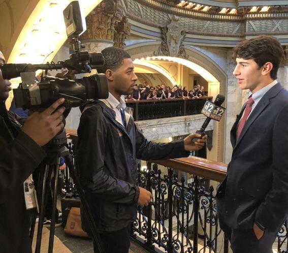 Camera crew interviewing student Andrew Sanli