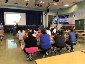 Parents listening to presenters
