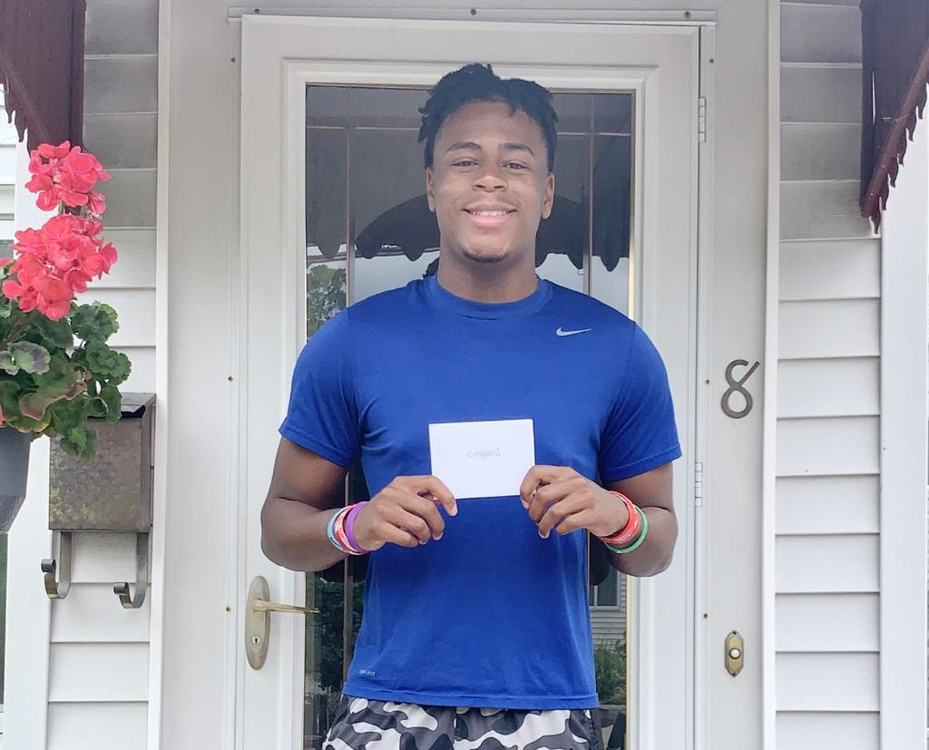 Student holding a gift card