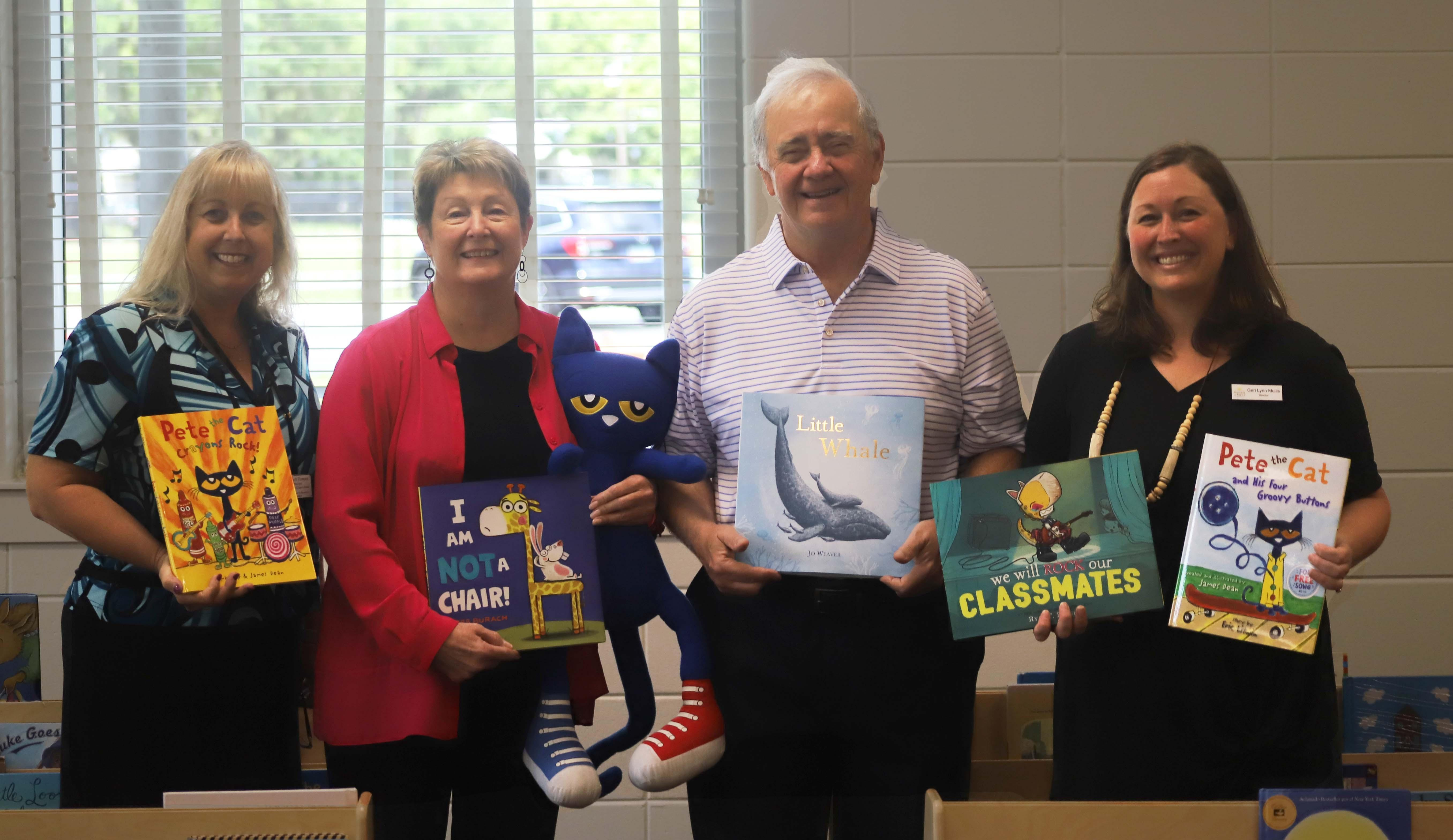 St. Simons Rotary Club members, along with the Marshes of Glynn Library, donate books to FACES PreK Center.
