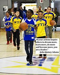 "Image of the NYI Basketball team entering the gym during the Pep Rally""If your actions inspire others to dream more, learn more, do more and become more, you are a leader."" -John Quincy Adams"