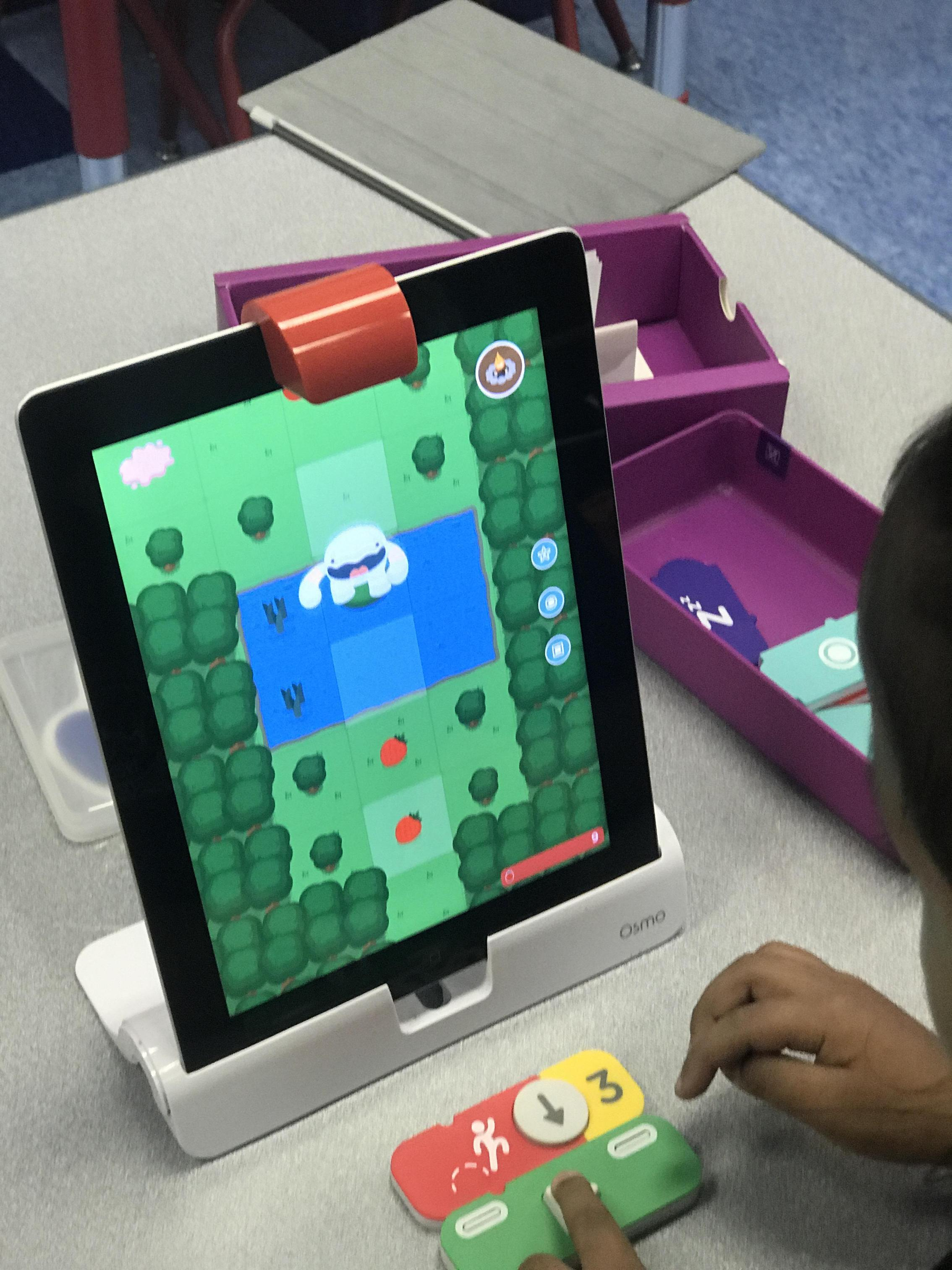 Student coding in the iPad
