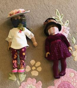 Photo of two American Girl dolls wearing face masks as part of the COVID-19 restrictions.