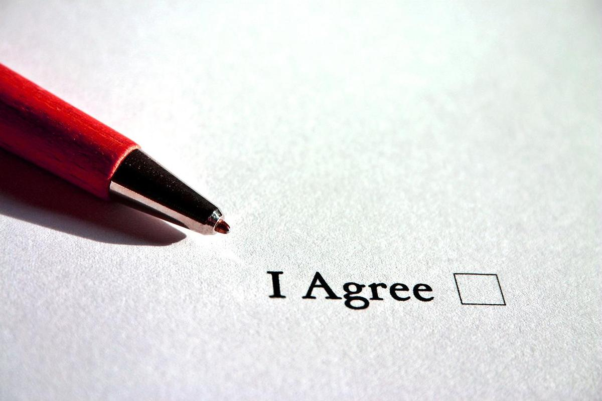 "A pen and checkbox saying ""I agree"""