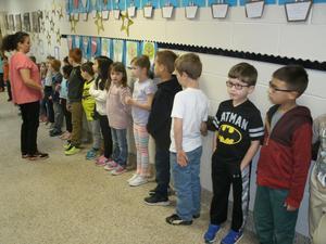 Students line hallway to wish EBOB Team good luck.