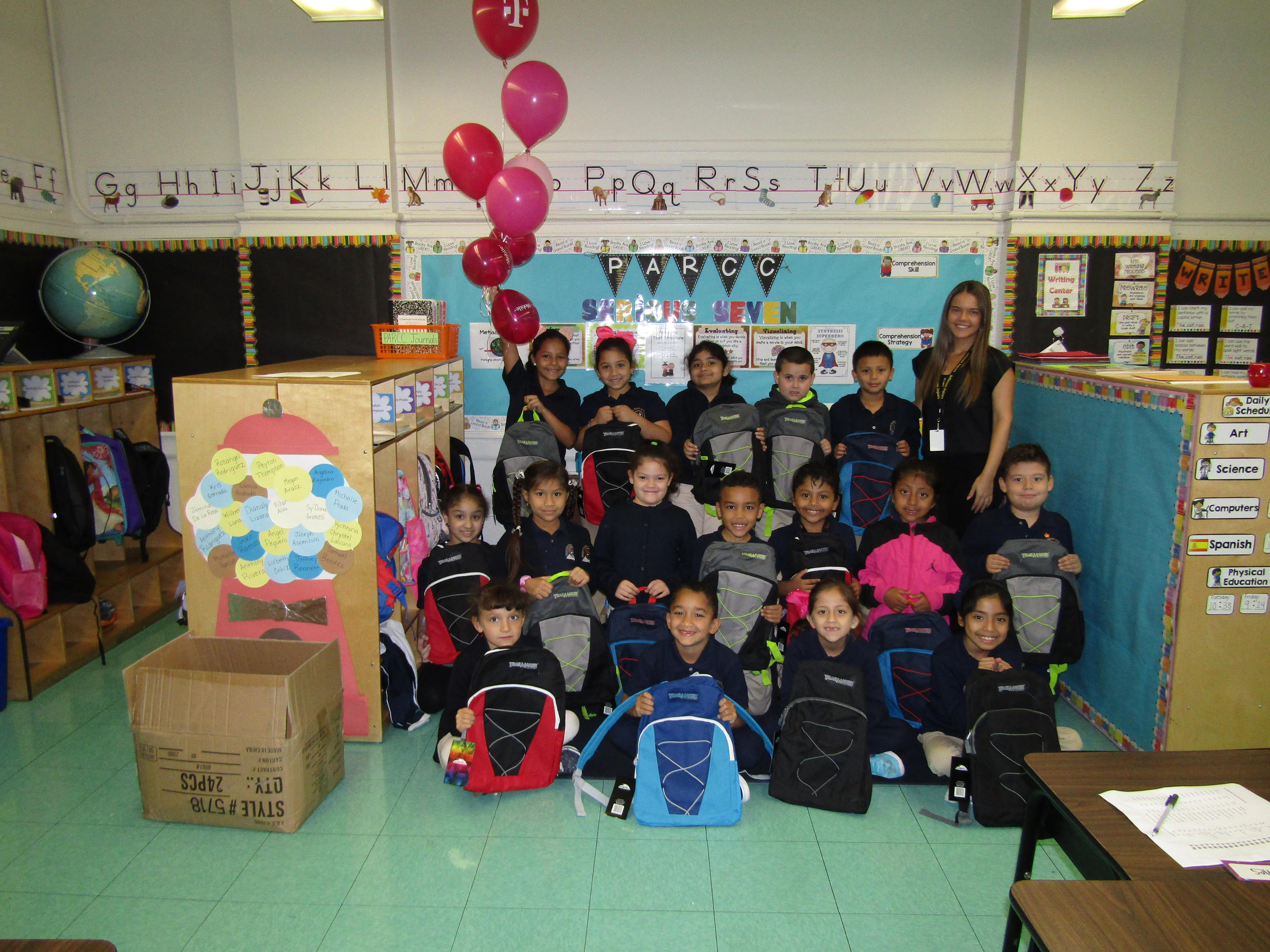 Class displaying their new free backpacks