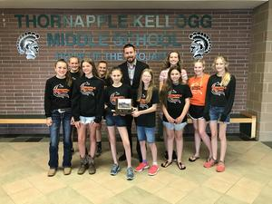 Members of the TKMS Equestrian team present their first-place trophey to Principal Brian Balding.