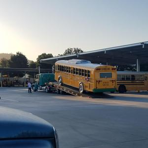 new electric bus being unloaded at EUSD transportation yard- 2