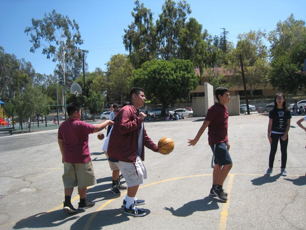 Marguerita students playing basketball during the Community Building Picnic