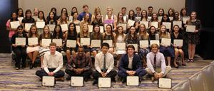Photo of senior students with their scholarships
