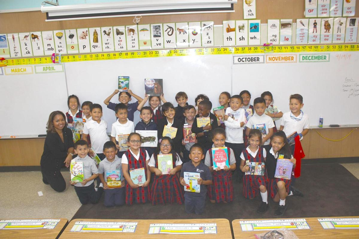 Students with books from the Bookmobile.