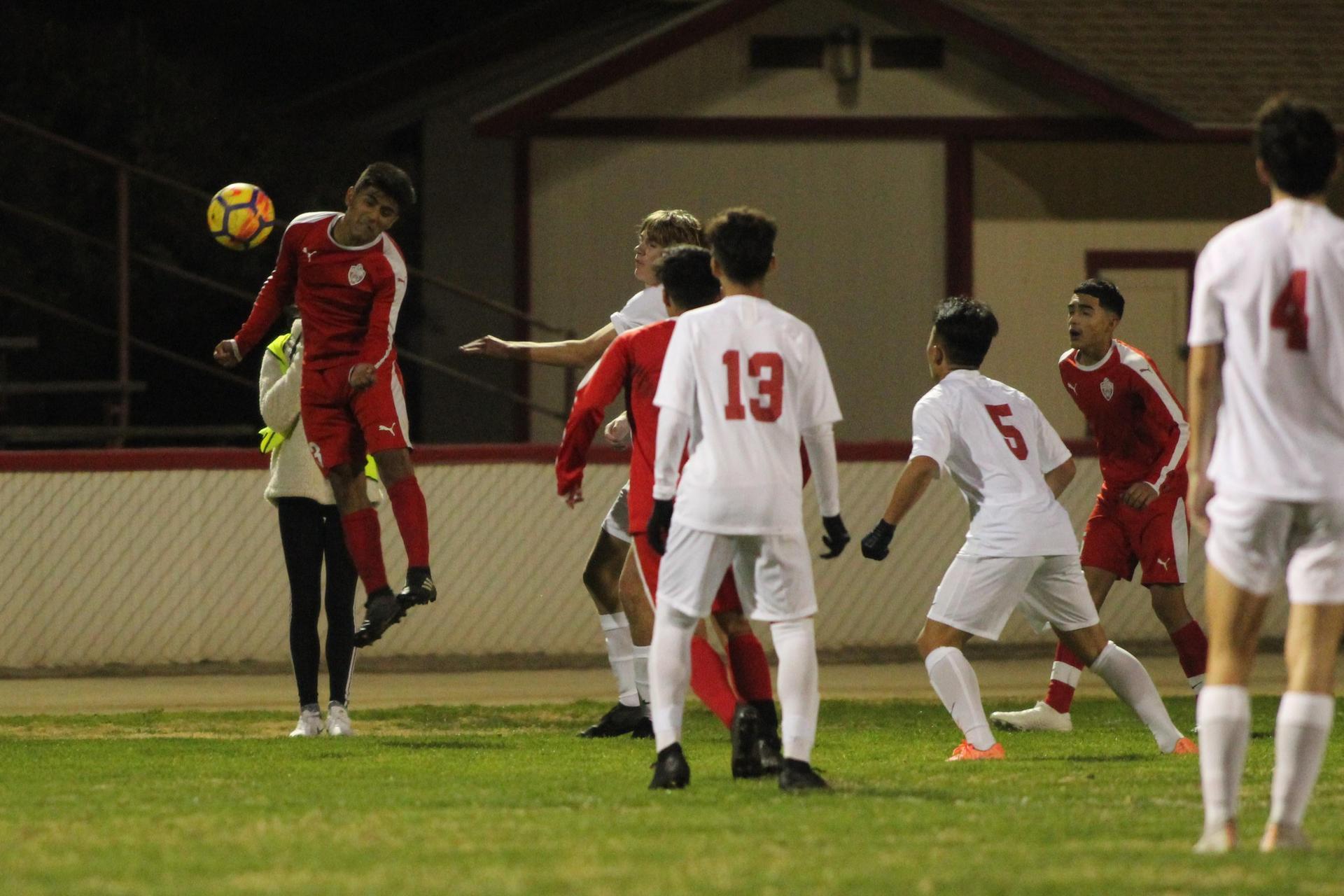Alejandro Montes headbutting the ball