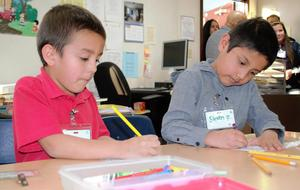 Foster Elementary students in transitional kindergarten and kindergarten practice reading aloud in pairs and work on English Language Arts assignments during the school's Think Together program on Feb. 7.