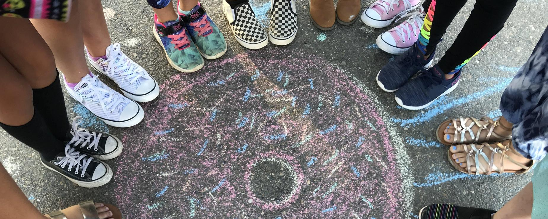 Donut sidewalk art and kids' feet