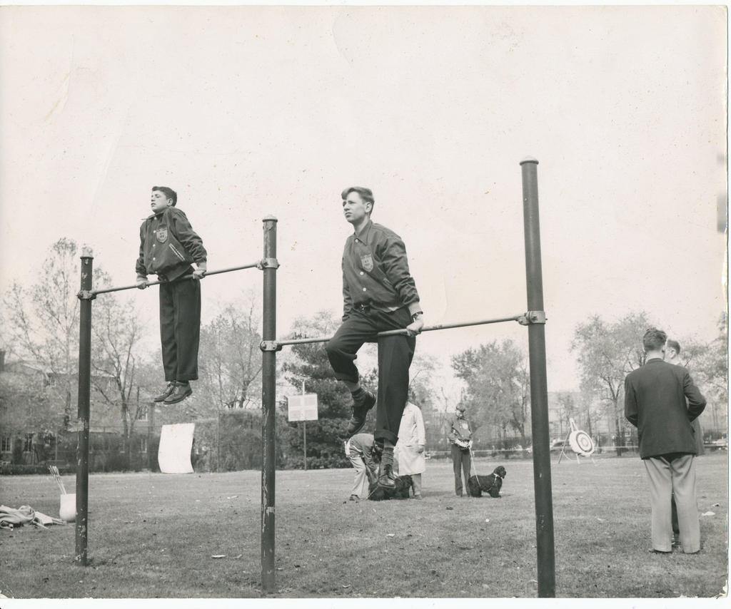 Students on high bars doing an exercise