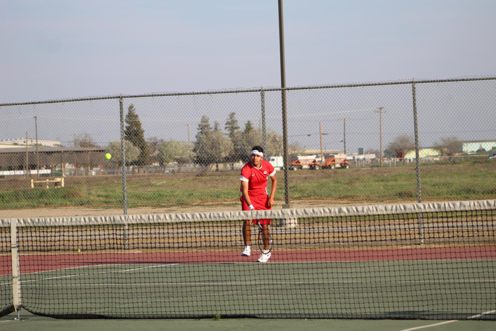 boys playing tennis against Madera South