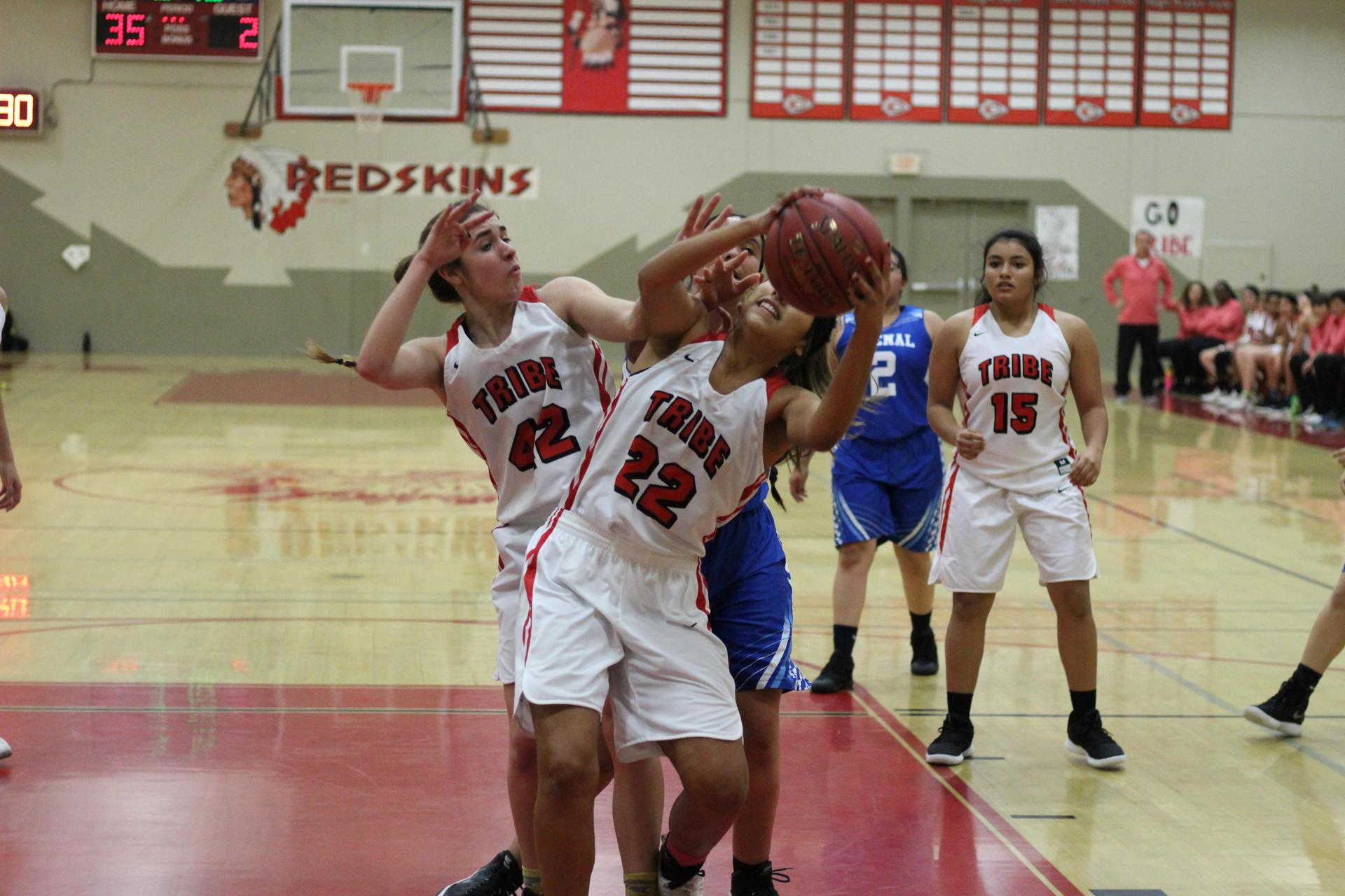 Girls playing basketball against Avenal.