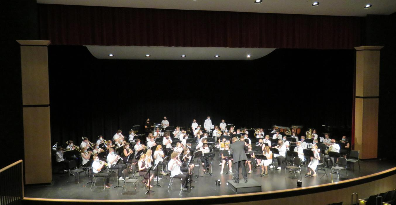 Members of the 6th grade band perform a spring concert.
