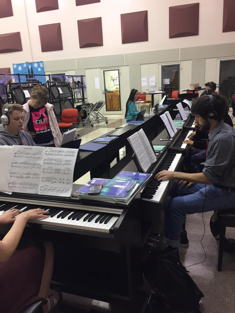 Student practicing in the piano lab