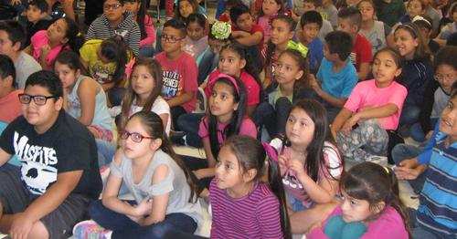 Students listening to a presentation.