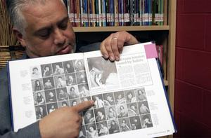 Author Roberto Rocha points to a photo of himself in his 1986 Edinburg High School yearbook.