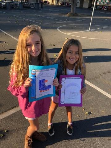 Two students with their published writing pieces
