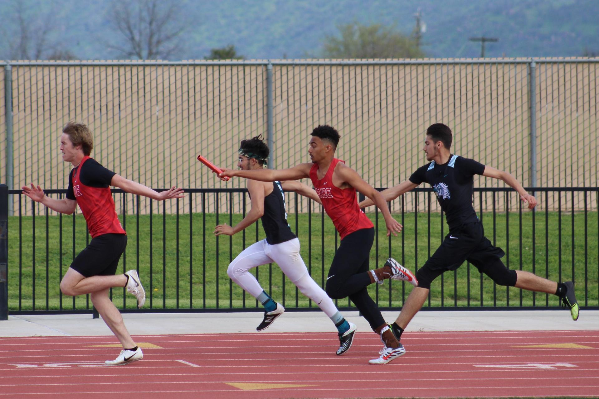 Track and field athletes in action at Orange Cove