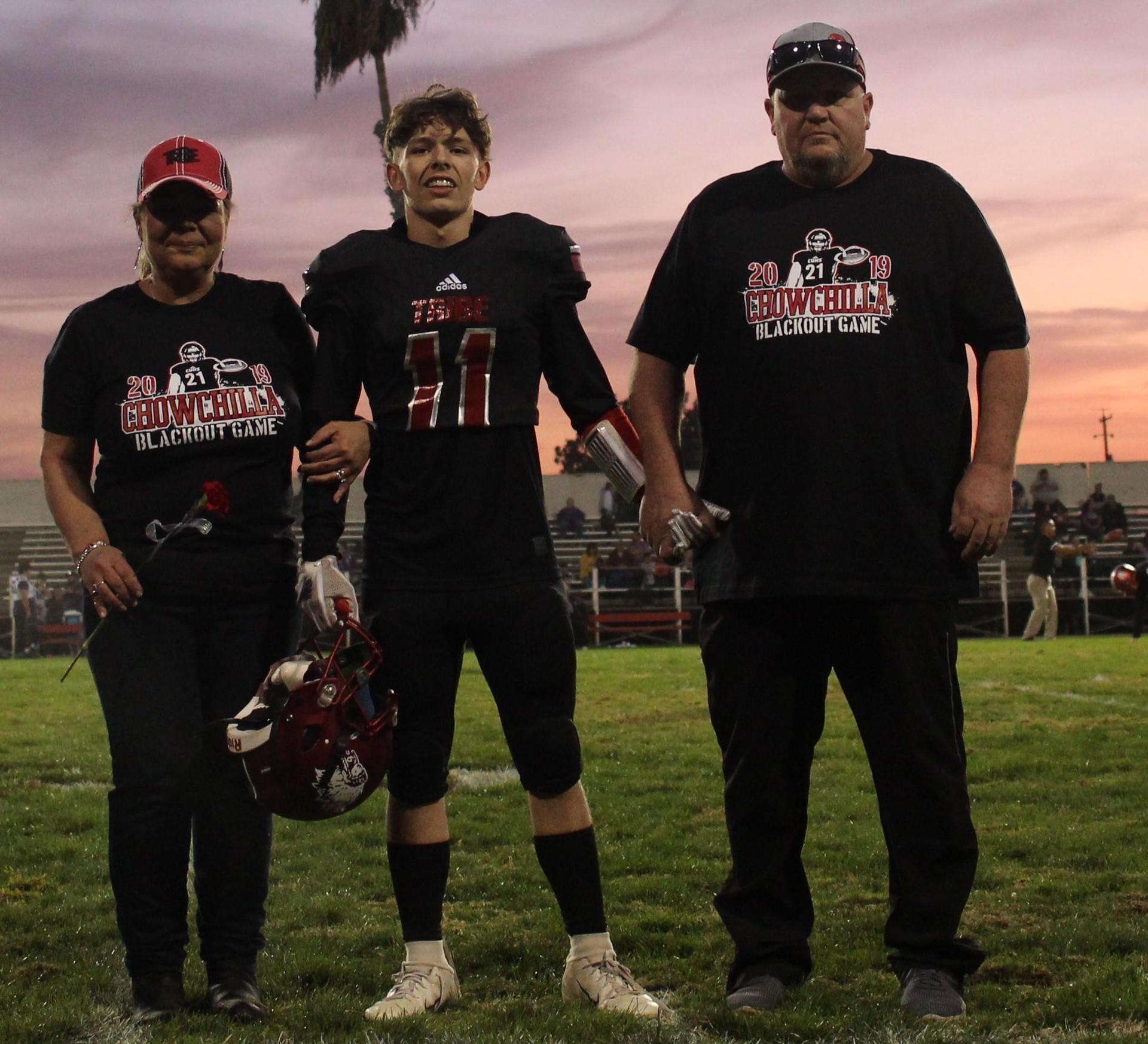 Senior football player Kyle MacDonald and his escorts.