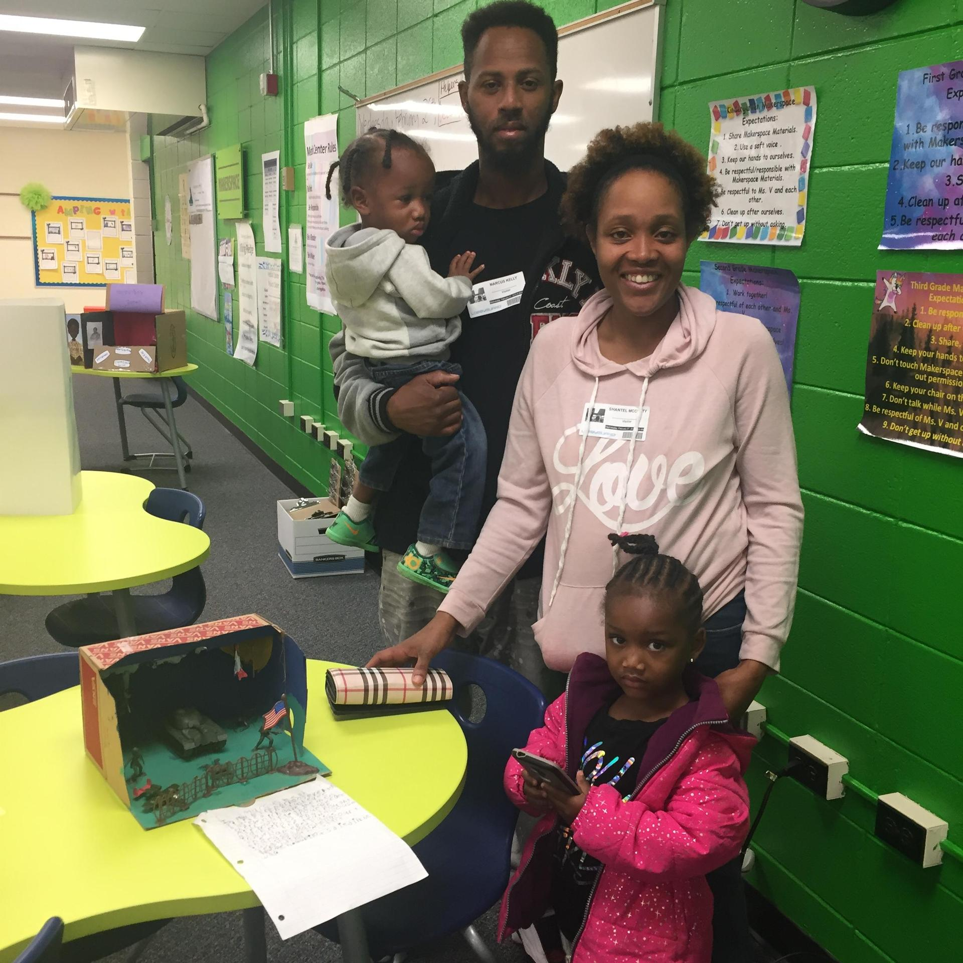 Parents observing the diorama projects done by Kindergarten and First grade at at the African American History Museum.