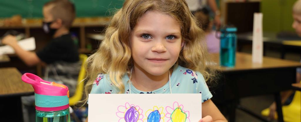Dabbs Elementary student shows off her art