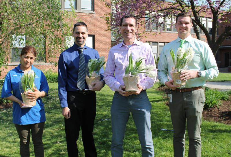 Westfield High School custodian Marina Rogel, mathematics teacher Anthony Meyers, English/journalism teacher Warren Hynes, and social studies teacher Brett Curtis are this year's recipients of excellence awards for going above and beyond their responsibilities each day.