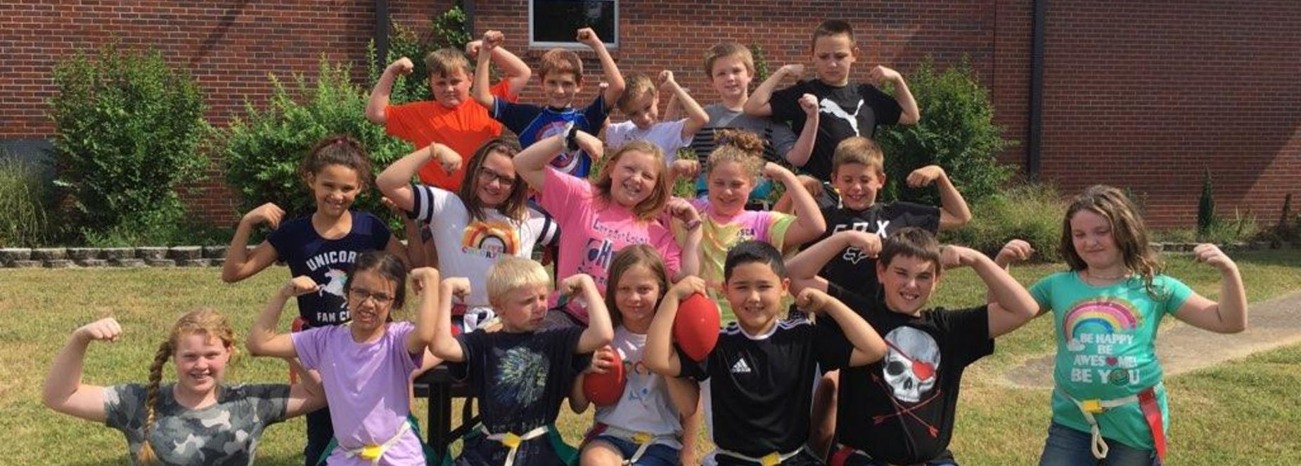 fourth grade flexing their muscles