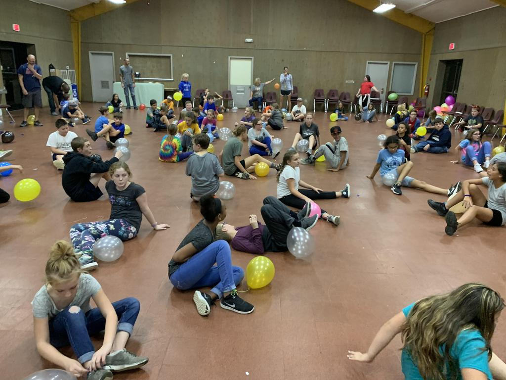 Students playing a balloon game