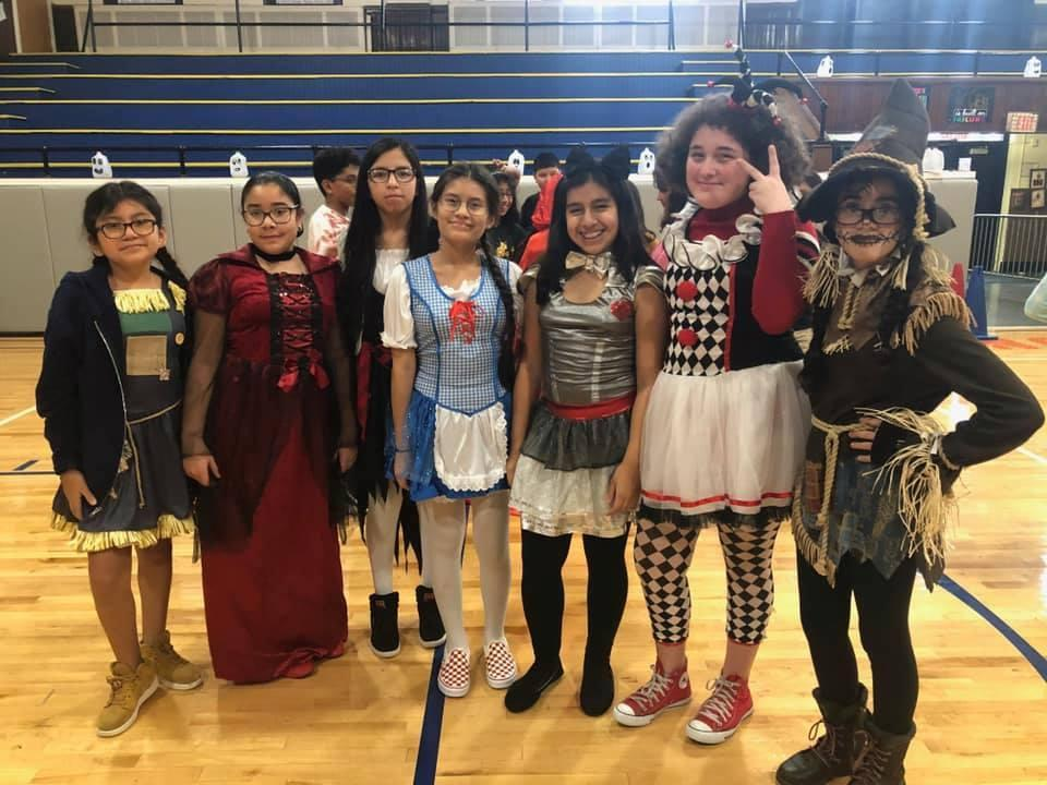 group of girls in costumes in the gym