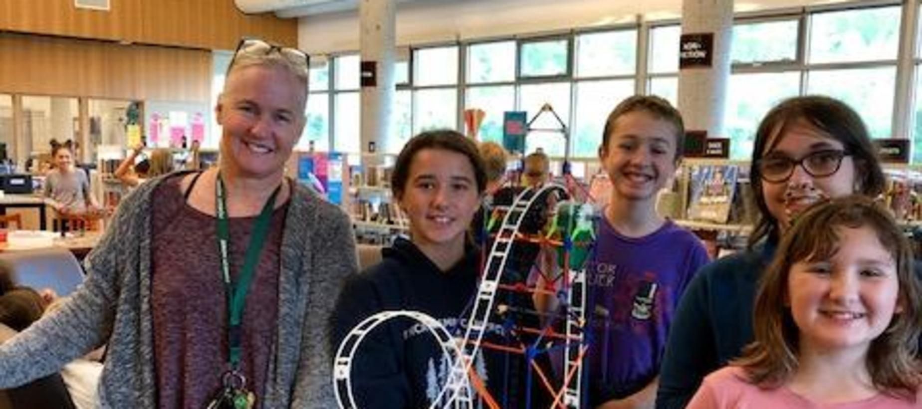 Ms. Snedeker and friends building roller coasters in our Maker's Space/Library