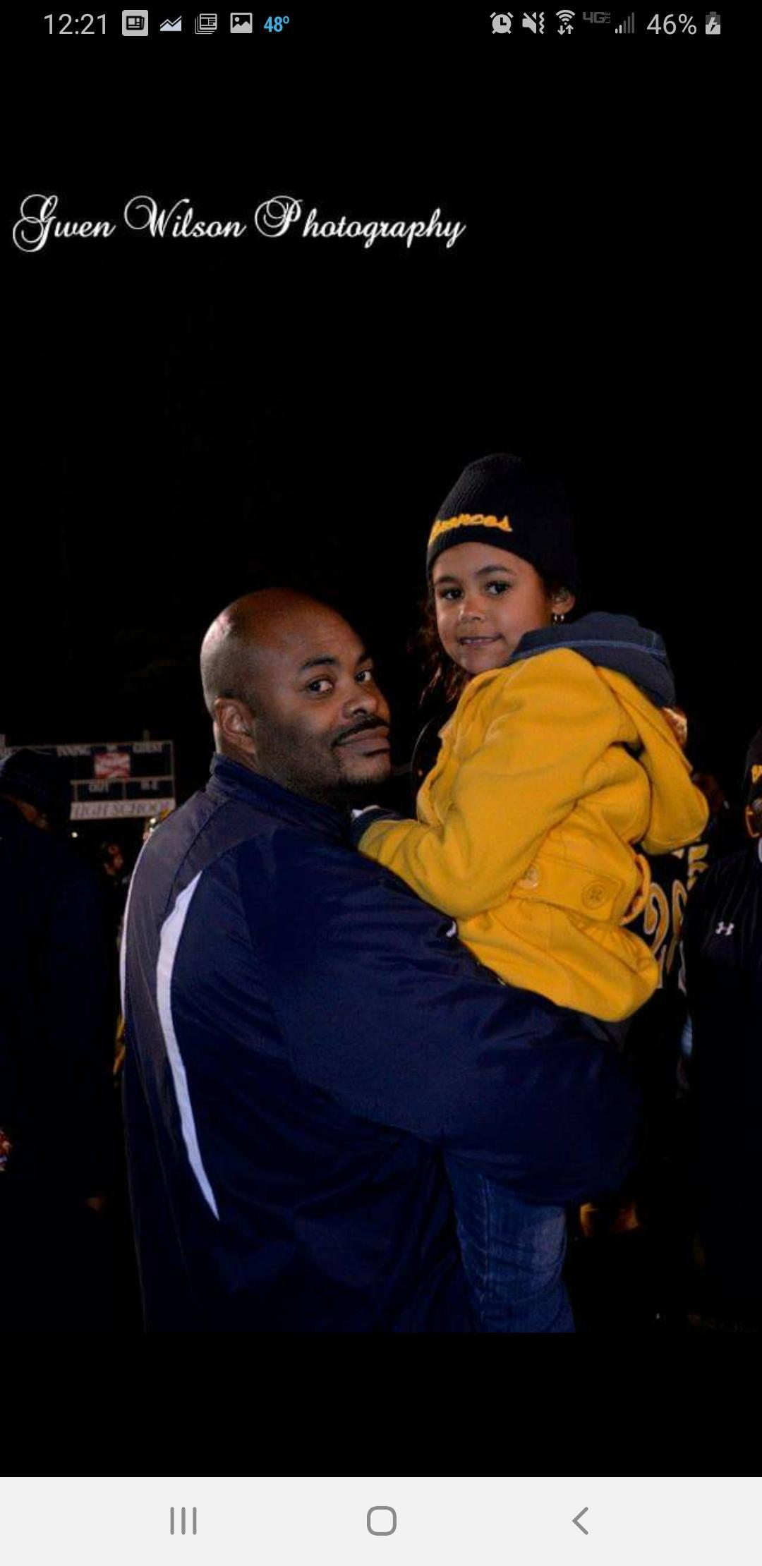 A coach and his daughter.