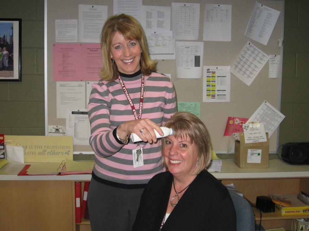 secretary pretends to treat teacher's forehead in office