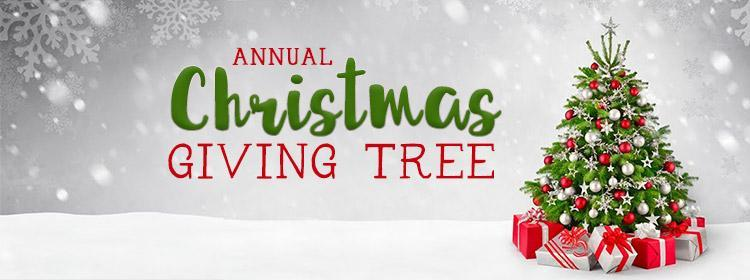 Text says Annual Christmas Giving Tree. There is a picture of a Christmas tree in the snow.
