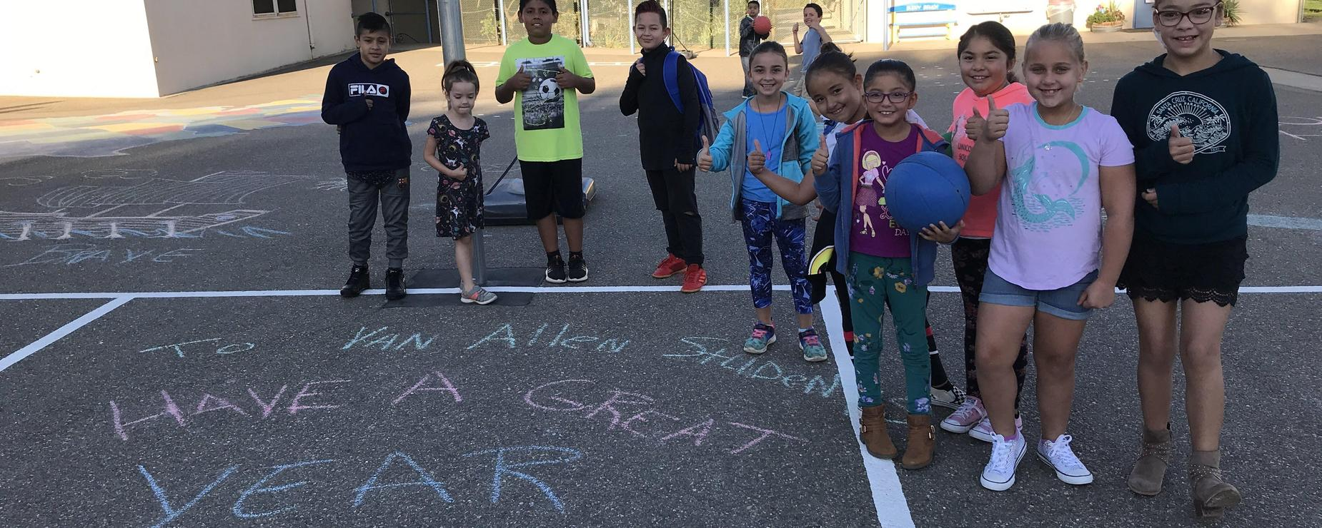 Positive messages in sidewalk chalk and kids