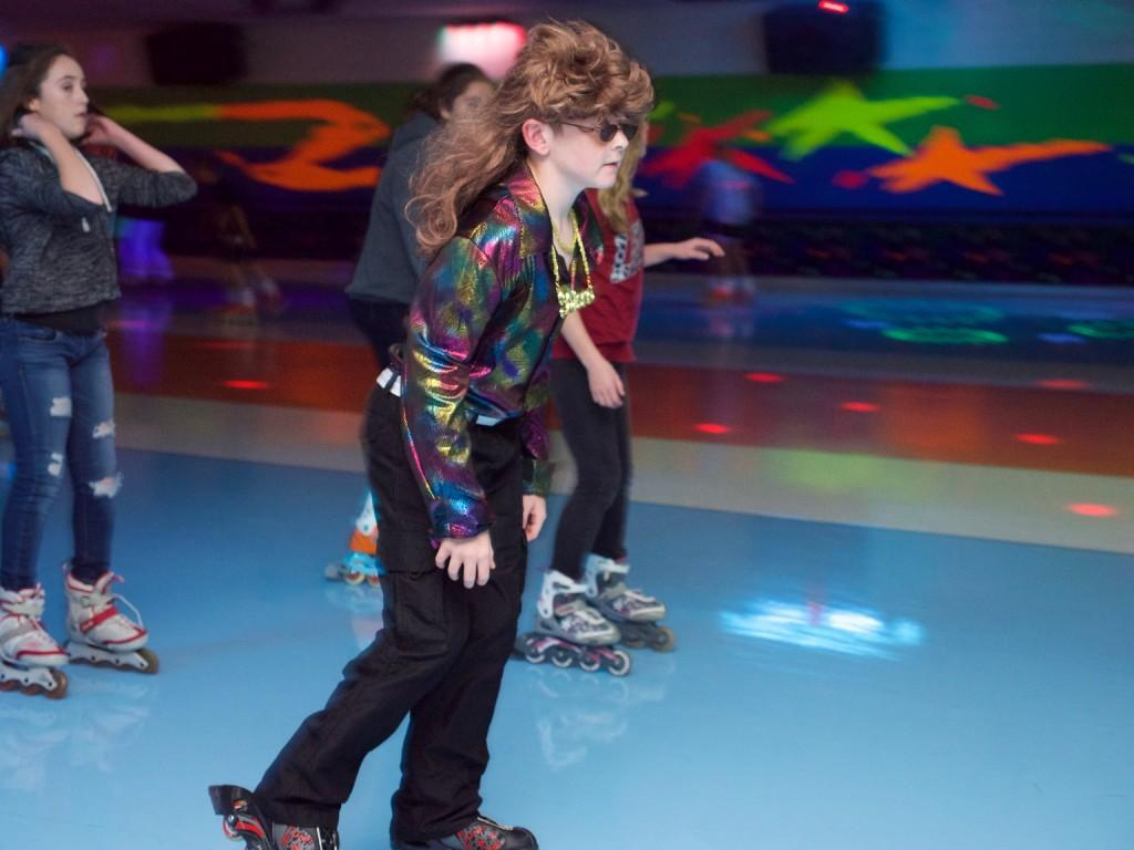 boy in hippie outfit skates