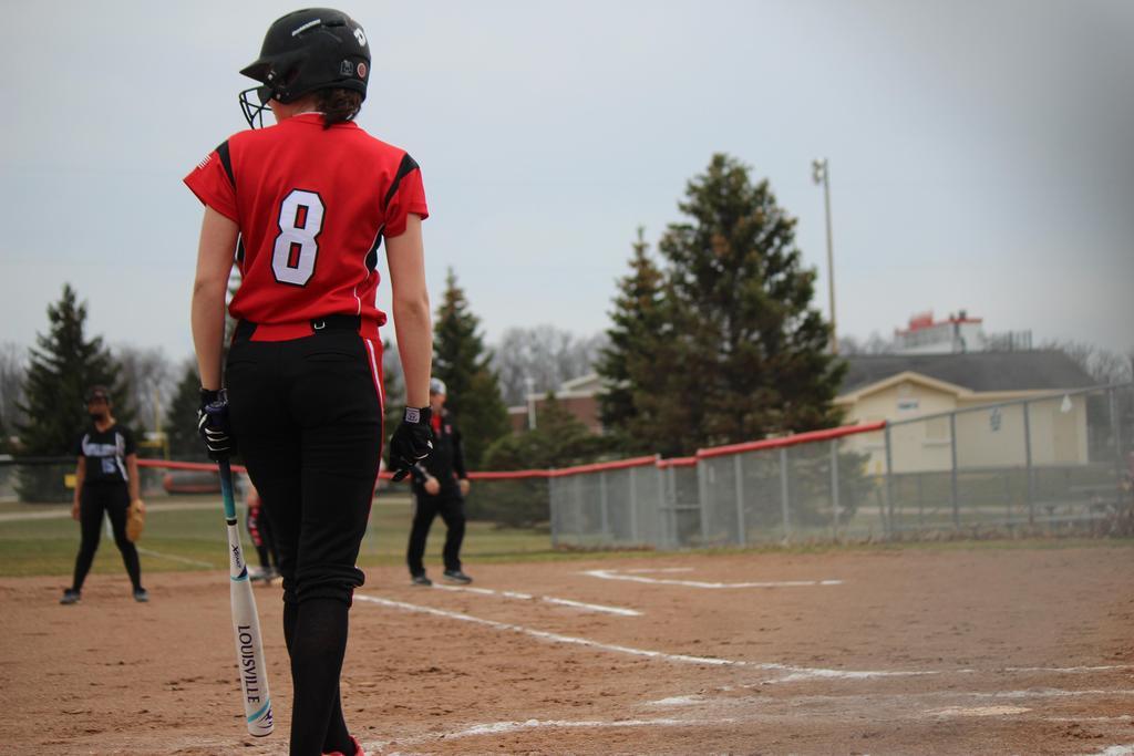 Softball player up to bat