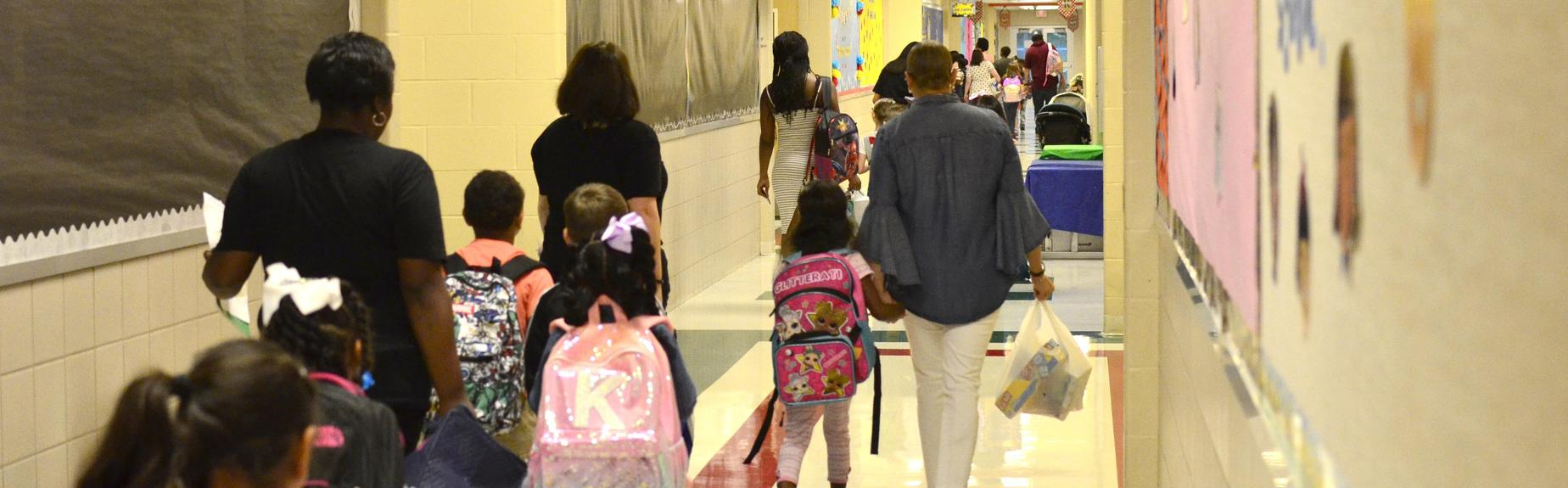 Students report to their classrooms on the first day of school.