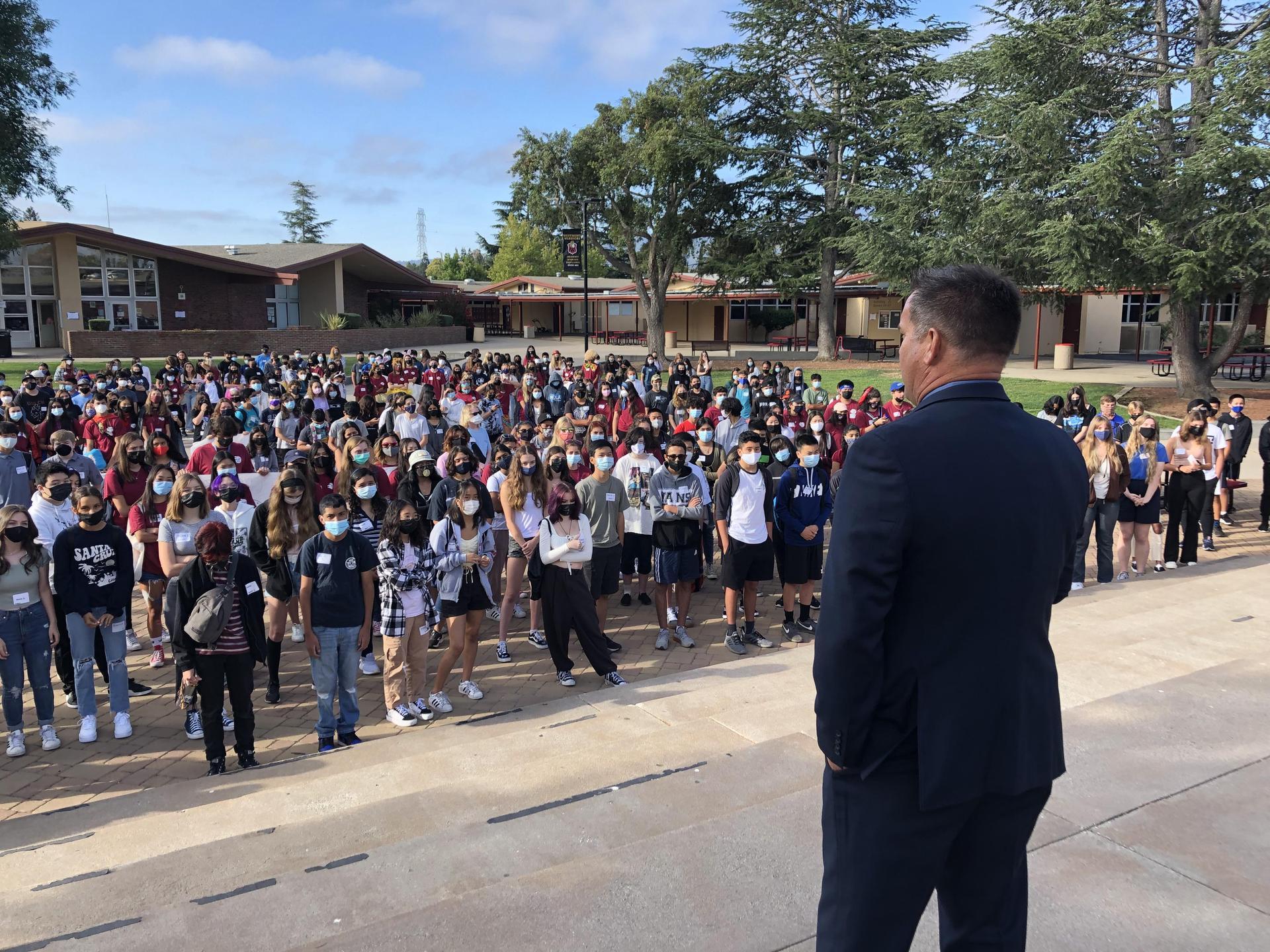 Photo of Mr. Miller speaking to a crowd at Freshman Orientation