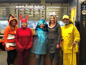 Tamaques principal David Duelks and his staff dress in a fisherman theme for Halloween.