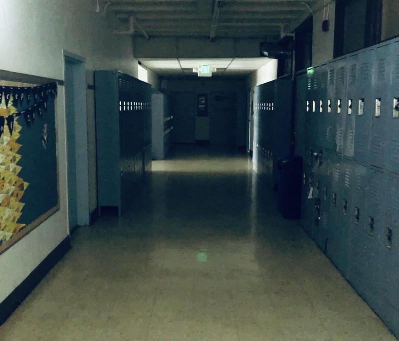 image of empty locker hallway of school