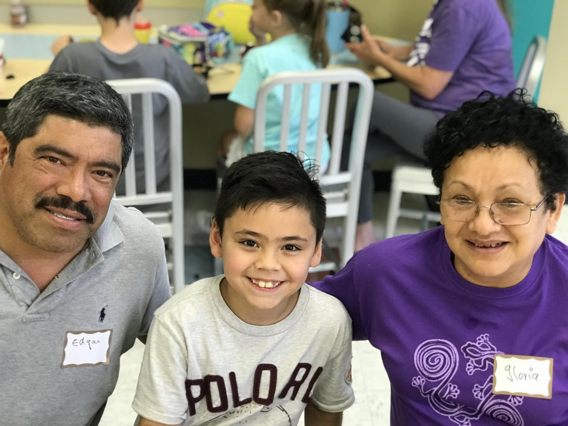 young boy with his grandmother and grandfather
