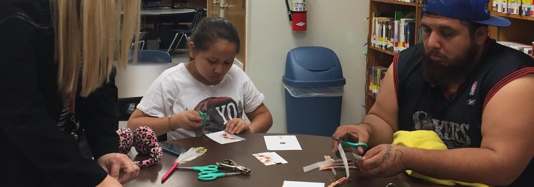 Father and daughter crafting in library