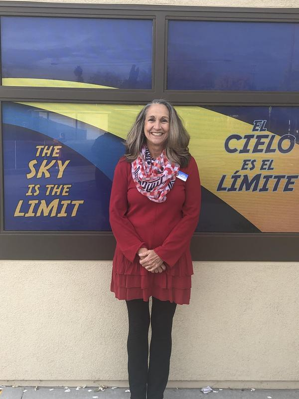 Colleen Barton in front of a Hemet Elementary sign.